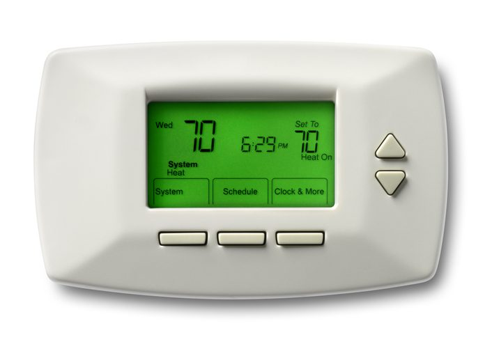 Polk Electric LLC | Programmable thermostat set at 70 degrees